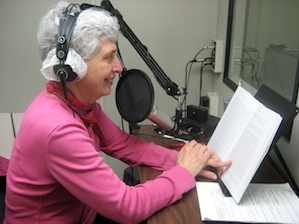Photo of Marti Miller recording in a booth at the Library.