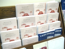 Picture of Braille books on a shelf.