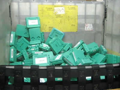 Photo of returned digital books waiting to be sorted at the Library.