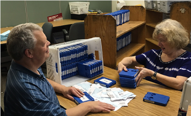 Volunteers sort through tapes