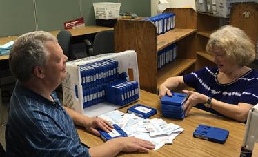 Volunteers sort through tapes